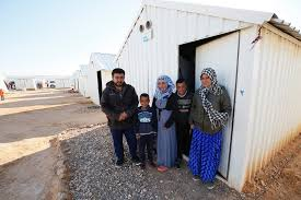 A Syrian refugee family in the Azraq camp, northern Jordan  (by DFID - UK)